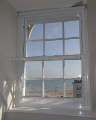 Tilt in Balanced vertical sliding sash secondary windows in a coastal setting